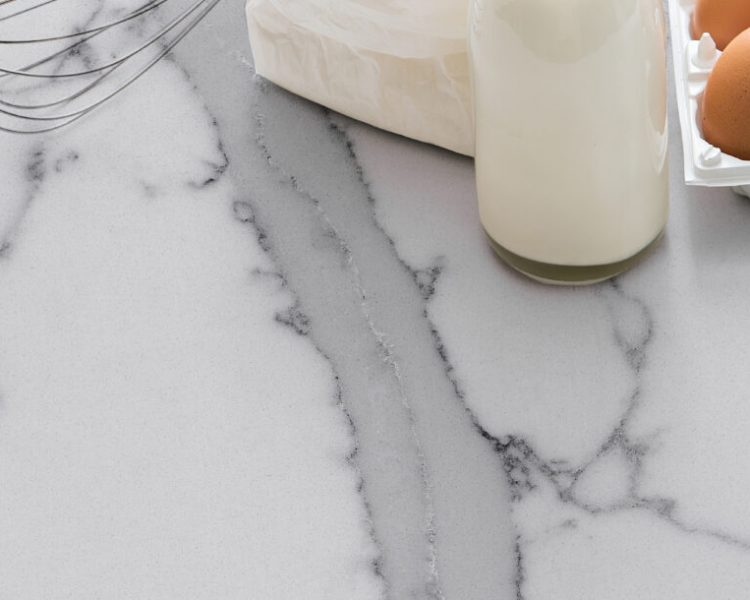 milk, eggs, flour and kitchen tools on white table